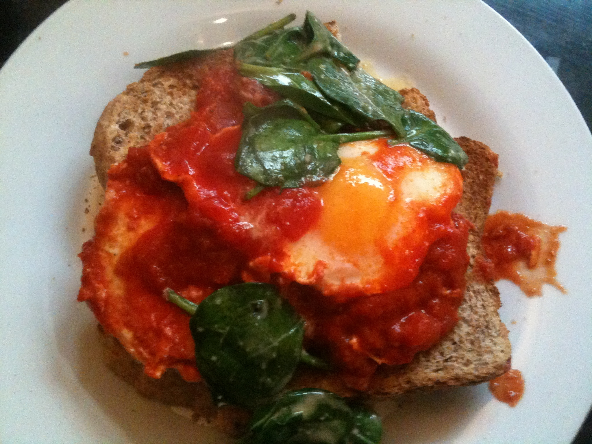 Baked Eggs In Tomato, Chilli, Garlic & Spinach